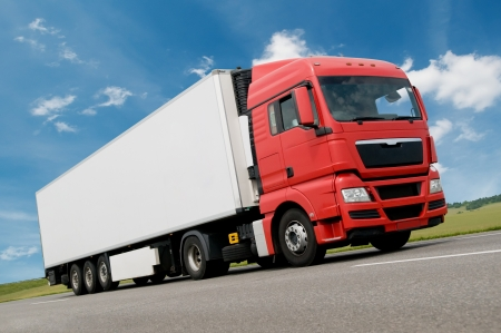 Red white Long vihicle truck in motion on road Stock Photo - 7565343