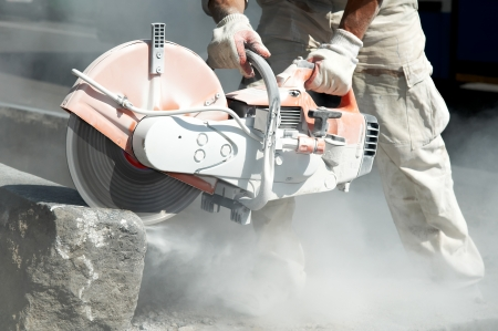 construction work of stone cutting by cut-off saw with diamond wheel Stock Photo - 7565335