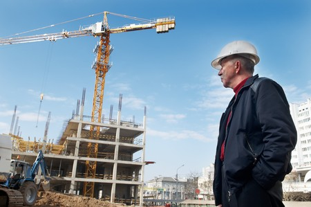 site construction: builder inspector worker checking a construction site works
