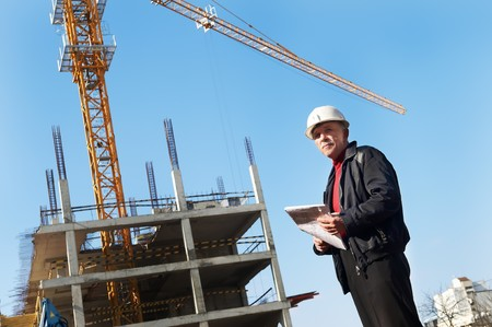 taskmaster: positive builder inspector worker at construction site Stock Photo