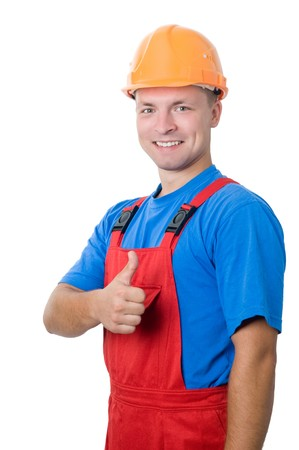 Smiley happy isolated builder worker with thumbs up hand gesture photo