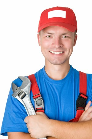 close-up portrait of happy repairman worker serviceman with adjustable wrench photo