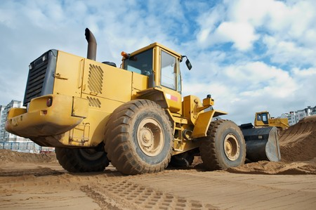 earthmover: Wheel loader machine loading sand at eathmoving works in construction site Stock Photo