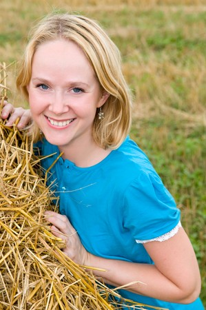 Young smiley attractive woman at countryside with straw haystack Stock Photo - 7818005