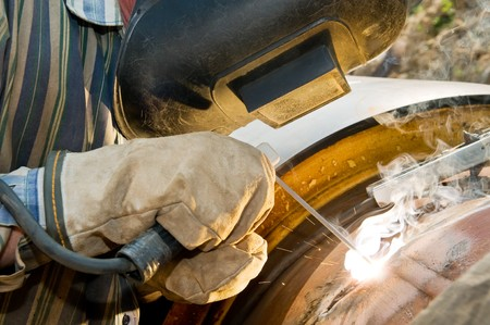 close-up welder works with electrode in protective helmet and gloves Stock Photo - 7818008