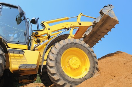 heavy earth moving excavator loader at construction works Stock Photo - 7818022