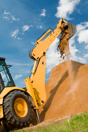 'earth mover': Backhoe loader excavator equipment at sand construction works Stock Photo