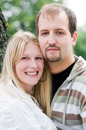 beatitude: Portrait of glad young man and smiling woman outdoors Stock Photo