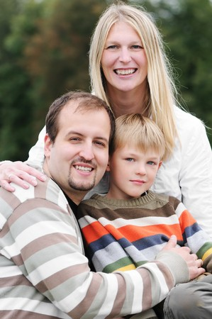 Smiling happy family – Mother, father and son outdoors Stock Photo - 7818012