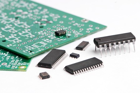 several integrated microelectronics components and green microcircuit board photo