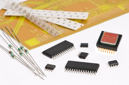 several integrated microelectronics components and yellow microcircuit board photo