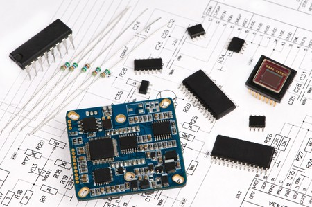 several integrated micro electronics components on microcircuit diagram drawing photo