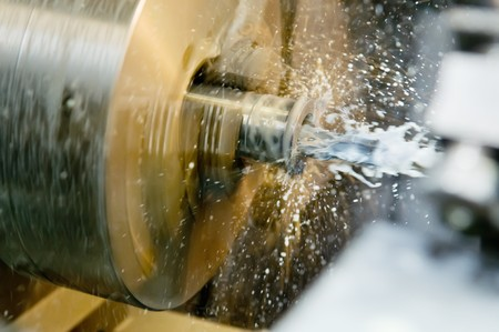 swarf: Operation of drilling a hole in blank on turning machine with metal-working coolant