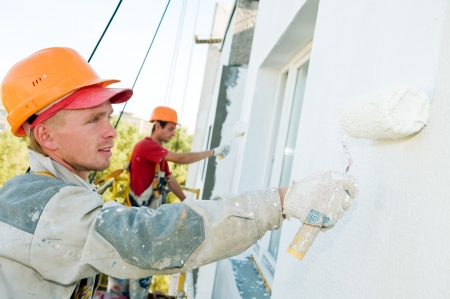 builder worker painting facade of high-rise building with roller Stock Photo - 7879958