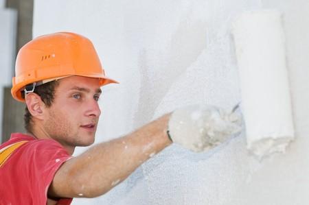 fachada de pintura de trabajador de generador de rascacielos con rodillos