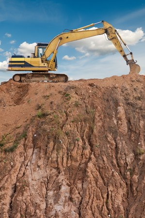 loader excavator in open sand mine over scenic blue sky Stock Photo - 7880075