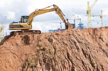 loader excavator in open sand mine over construction site Stock Photo - 7880076