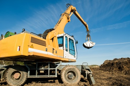 excavator loader machine during earthmoving works outdoors at construction site Stock Photo - 8202918