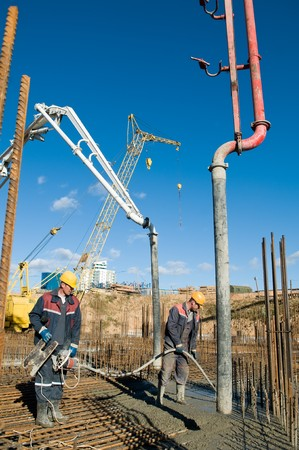 builder laborers works on construction site. Concrete pump and Vibration Stock Photo - 8207159