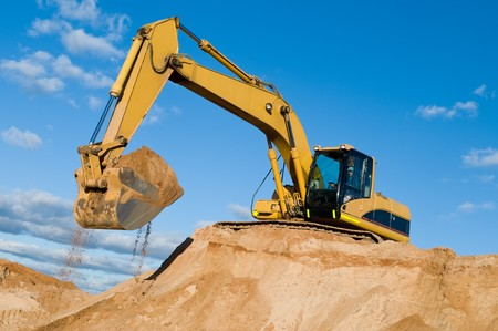equipment: excavator loader machine during earthmoving works outdoors at construction site