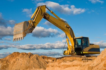 excavator: excavator loader machine during earthmoving works outdoors at construction site