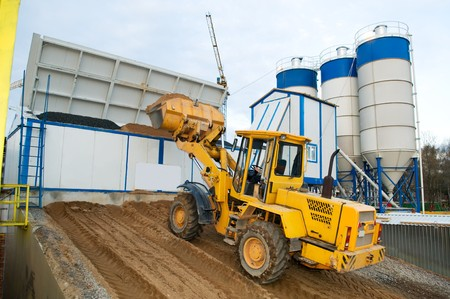 hopper: front-end loader loading with sand bunker of Stationary Concrete Batching Plant