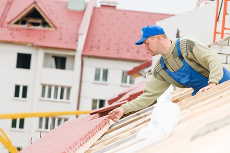 trussing: builder worker laborer at roofing tiling works