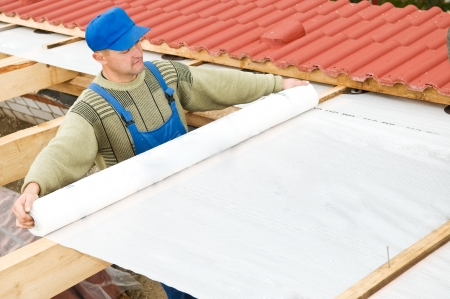 works for protection the construction of the roof from leaking water and the outside moisture thermal insulation photo