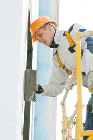 facade thermal insulation works with stopping and surfacer Stock Photo - 8207028