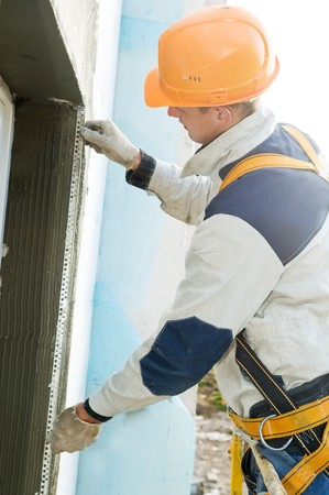facade thermal insulation works with stopping and surfacer photo
