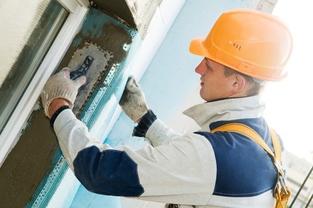 facade thermal insulation works with stopping and surfacer Stock Photo - 8207094