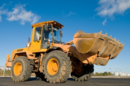 One Loader excavator construction machinery equipment over blue sky Stock Photo - 8306931