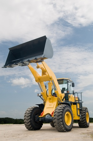 One Loader excavator construction machinery equipment over blue sky Stock Photo - 8306920