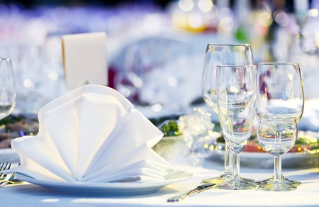 catering table: catering table set service with silverware, napkin and glass at restaurant before party
