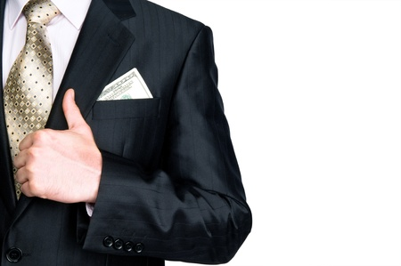 Close-up of businessman with dollar banknote in suit pocket and hand�s thumb up photo