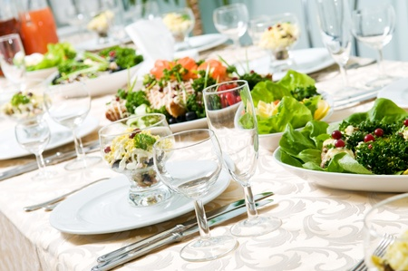 catering service: catering table set service with silverware and glass stemware at restaurant before party Stock Photo