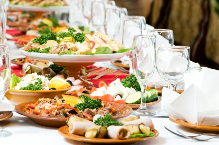 cater: catering table set service with silverware and glass stemware at restaurant before party Stock Photo