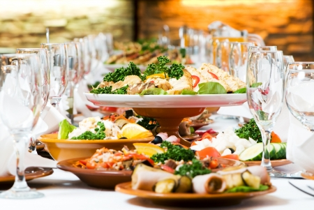 restaurant food: catering table set service with silverware and glass stemware at restaurant before party Stock Photo