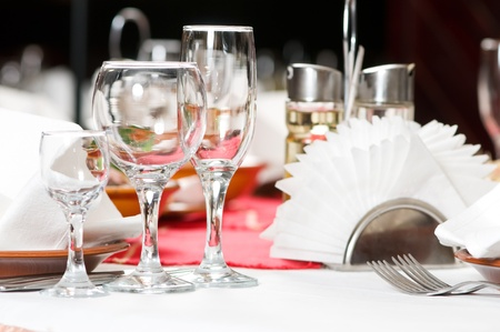 banquet table: catering table set service with silverware, napkin and glass at restaurant before party