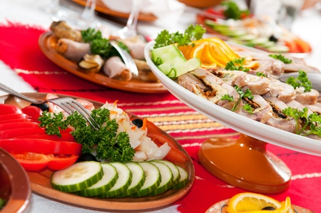 catering table: catering table set service with silverware and glass stemware at restaurant before party Stock Photo