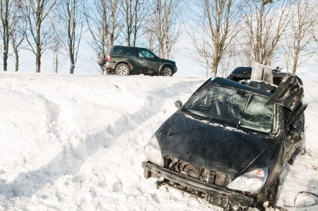 safe driving: car crash accident at snow road in winter Stock Photo