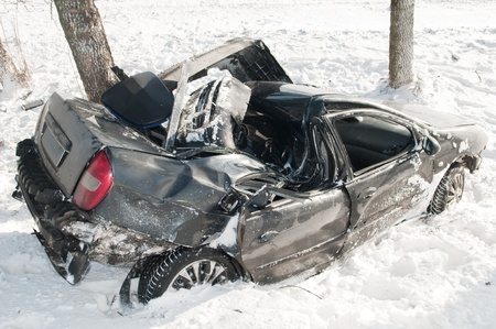 car crash accident at snow road in winter photo