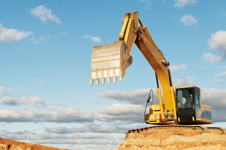 track-type loader excavator at construction area photo