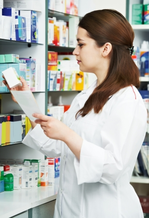 salesperson: Pharmacy chemist woman in drugstore Stock Photo