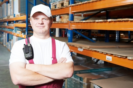 caucasian young manual worker in warehouse photo