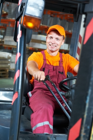 warehouse worker driver in forklift Stock Photo - 9920158