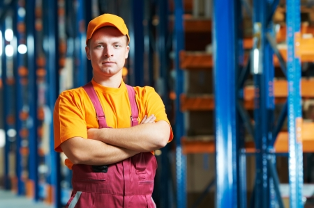 warehouse equipment: caucasian young manual worker in warehouse