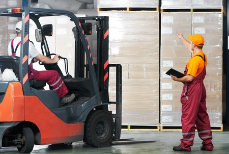 warehouse equipment: warehouse works (forklift and workers) Stock Photo