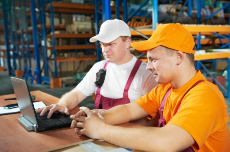 manual workers in warehouse Stock Photo - 9920659