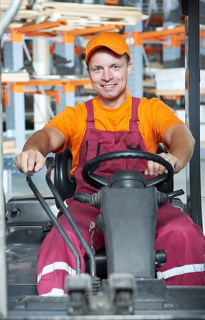 warehouse worker in forklift loader photo